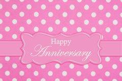 Happy Anniversary greeting on bright pink and white polka dot fabric stock illustration