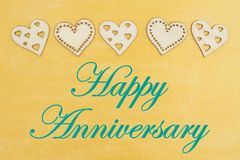 Happy Anniversary greeting with wood hearts royalty free stock images
