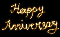 Happy Anniversary Signage. Written with fire flare effect on Black Background Stock Images