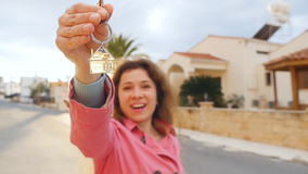 Happy apartment owner or renter showing keys. And looking at you stock footage