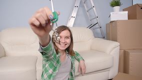 Happy woman apartment owner or renter showing keys stock video