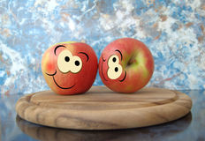 Happy apples. Apples with nice eyes and smile Royalty Free Stock Images