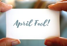 Happy April Fools Day design. Hands holding card. stock photography