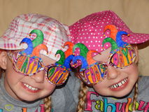 Happy April Fools Day. Twin sisters having fun on  April Fools Day wearing big fake teeth Stock Image