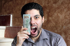 Happy arab businessman with money