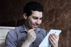 Happy arab businessman with phone and tablet Stock Photos