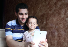 Happy arab egyptian father with daughter taking selfie royalty free stock photography