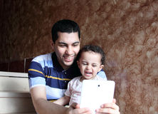 Happy arab egyptian father with daughter taking selfie Royalty Free Stock Images