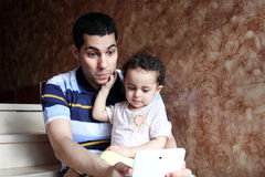 Happy arab egyptian father with daughter taking selfie royalty free stock photo
