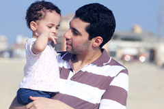 Happy arab egyptian father holding his daughter Stock Images