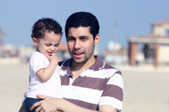 Happy arab egyptian father holding his daughter Royalty Free Stock Photography