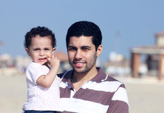 Happy arab egyptian father holding his daughter Stock Photo