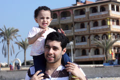 Happy arab egyptian father holding his daughter stock photos