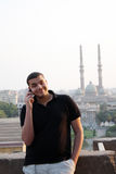 Happy arab egyptian young businessman talking with phone Stock Image