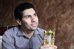 Happy arab egyptian young man with ramadan lantern. Image of arabian egyptian business man wearing shirt and feeling happy while holding ramadan lantern