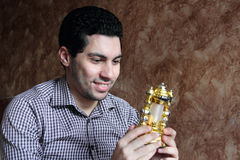 Happy arab egyptian young man with ramadan lantern royalty free stock image