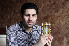 Happy arab egyptian young man with ramadan lantern royalty free stock photo