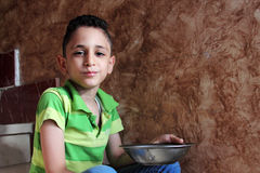 Happy arab muslim child eating Royalty Free Stock Photos
