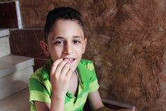 Happy arab muslim child eating Stock Photos
