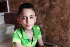 Happy arab muslim child eating Royalty Free Stock Photo