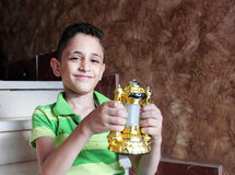Happy arab muslim child with ramadan lantern stock photo
