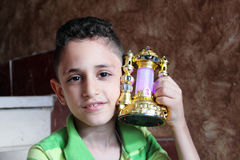 Happy arab muslim child with ramadan lantern royalty free stock photo