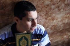 Happy arab muslim man with koran or quran holy book Stock Image