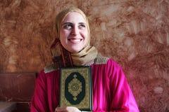 Happy arab muslim woman with Koran islamic holy book Stock Image