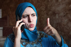 Happy arab muslim woman with mobile Royalty Free Stock Photography