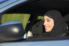 Happy arab saudi woman driving a car Stock Image