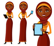 Happy arab woman character with tablet. Pleasantly smiling musli Royalty Free Stock Photo