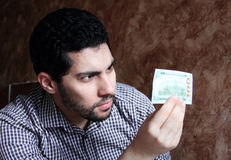 Happy arab young businessman with dollar bill money Stock Photo
