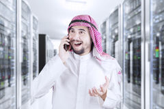 Happy Arabian man speaking on smartphone Royalty Free Stock Photos