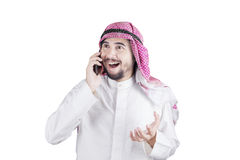 Happy Arabian man talking on cellphone Stock Image