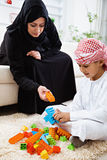 Happy Arabic child at home with his mother Royalty Free Stock Images