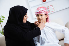 Happy Arabic child at home with his mother Stock Images