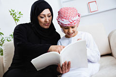 Happy Arabic child at home with his mother Royalty Free Stock Image