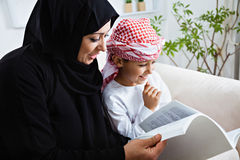Happy Arabic child at home with his mother Stock Photography