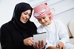 Happy Arabic child at home with his mother Stock Image