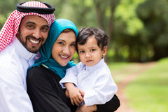 Happy Arabic family. Portrait of Arabic family at the park Stock Photos
