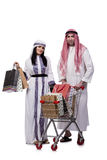 The happy arabic family after shopping isolated on white. Happy arabic family after shopping isolated on white stock image