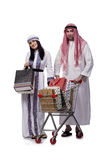 The happy arabic family after shopping isolated on white. Happy arabic family after shopping isolated on white stock photography