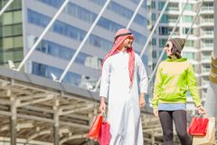 Arabic men shopping. Happy Arabic men with city shopping hand holding paper bags stock photos
