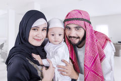 Happy Arabic parents and their child at home Royalty Free Stock Images
