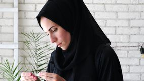 Happy woman looking at pregnancy test. Happy Arabic woman looking at pregnancy test stock video