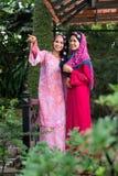 Happy Arabic women. Image of talking Arabic women standing outside Royalty Free Stock Photos