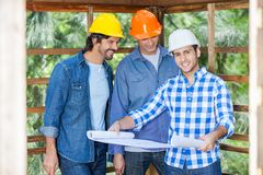 Happy Architect With Colleagues Analyzing Stock Photo