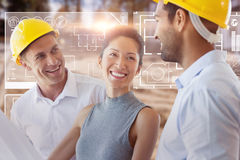 Composite image of happy architect discussing over blueprint. Happy architect discussing over blueprint against high angle view of muddy construction site Royalty Free Stock Photo