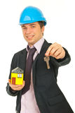 Happy architect giving keys Royalty Free Stock Photo