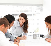Happy architect with her team during a meeting Royalty Free Stock Images